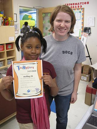Emily and child with ToxMystery certificate